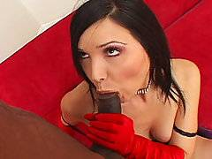 This MILF has dark hair and porcelian skin and is wearing garters, stockings and long red gloves.  The perfect outfit for a woman who knows what a mans needs are and aims to please.  She wants pleasure herself so that is why she wants to fuck a black cock  One that is thick, long and something better than she has ever had it before.  She treats this black monster cock as a gift, gently trying to swallow it and make it wet.  When he enters her and goes deep her small tits bounce, her legs shake.  This is exactly what she needed.