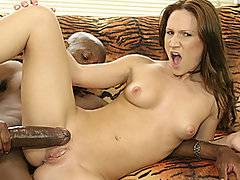 You will never hear a girl scream as much as tiny young slut Gia Padova when she takes on the huge black pole of ebony porn stud Mandingo.  She looks visibly intimidated by his massive schlong, and when she holds it in both hands she can barely wrap her hands around it.  The black stud lays her on her back on the couch with her legs spread, roughly fingering her tight gash before he impales her on his black shaft.  This hot and horny slut loves to get fucked like this, holding onto his buttocks and begging him to drive deeper.  She almost gets broken in half by this black monster.  It's seriously more than she can take!