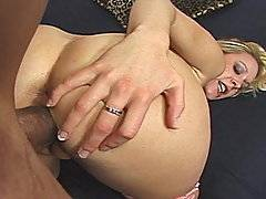 Erin is a little blonde slut who loves the black meat stuffed in her pussy.  She's eager to get fucked so she starts undressing for the camera as she shows off her busty tits and her bubble-butt ass.  Erin then lies on the couch while spreading open her pussy lips for some penetration.  She masturbates for a bit and then she's given a monster black dick to suck on.  She can barely fit his big cock in her mouth and then he stuffs it right up in her pussy.  She gets a good stretching of her little pink slit in all positions.  He works over that white bitch's cunt for awhile until he feeds her a load of his chocolate milk.