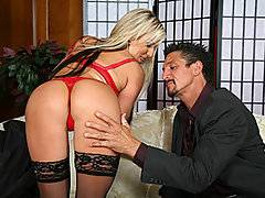 Big titty blond MILF Carolyn Reese is the kind of harlot who is impressed by superficial things like money and power.  She comes across older stud Tommy Gunn, who looks so wealthy and respectable in his suit that Carolyn immediately grows wet between her legs.  She tries to play it cool at first, but finally she can't help herself any longer - she needs some of that alpha male cock!  She strips down to her bra, panties and stockings, leaving her high heels on as she bends over the back of the sofa and tempts Tommy with her beautiful butt.  Soon she's got Tommy's big cock thrust down her throat, and then he stuffs it into her wet pussy.