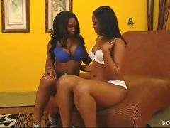 Two big boobed chocolate sistas kiss and tender each other.
