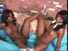Horny chocolate sistas spread their legs together to fuck one toy.