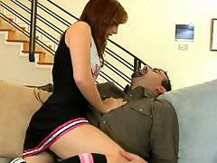 Beautiful redhead cheerleader Dani just got done with practice before going home with this horny couple interested in her flexibility. They Strip her out of her uniform then quickly show Dani what team spirit is all about by splitting her tight twat wide with a thick cock while feeding her a moist muff megaphone to moan her cheers into.