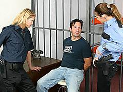 Poor crim Gary is stuck behind bars again, and his luck is only about to get worse - or better, depending on your point of view!  Two slutty prison guards take a liking to him, teasing him and rubbing their bodies against him.  They pull off his clothes, leaving him vulnerable, naked and handcuffed in his chair.  With their rubber gloves on, they spit on his semi erect cock and start to jerk it.  Soon he is rock hard and moaning for release as the girls expertly work his shaft without letting him cum.  The dirty whores even stick a finger up his ass while he helplessly cums into a glass, and they keep his pathetic dribble of semen for later.