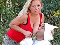 When busty blond matron Andrea sees big cock adult baby Oliver lying helplessly in the field, she has to help the little chap out!  However, the ministrations of this big titty blond come at a price - she demands that she be allowed to bang the diaper clad male with a big strap-on!  The adult baby acquires a taste for this anal treatment, eventually getting on top and bouncing up and down on top of the strap-on in reverse cowgirl.  What a naughty little bugger - look at how big the little fucker\'s cock is while he\'s taking that big strap-on up his butt!  Andrea lies next to the adult baby on the grass and jerks off at the end of the movie.
