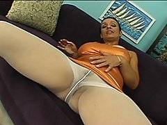 Brunette MILF Gabrielle talks to the camera while she spreads her legs and plays with her pussy through her white nylons.  She slides her dress down her body to free her large tits, and she\'s joined by a horny young man.  He tears a hole in the crouch of her nylons to eat her out and finger her wet hole, and she returns the favour by sucking his hard cock.  She climbs on top to ride him cowgirl, and he fucks her doggy-style.  He lays beside her to fuck her up her tight ass while spooning her, and she has her butt hole plugged missionary.  He finally blows his load all over her large breasts.