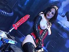 I can almost guarantee you haven\'t seen anything like this before. Nikki Dyme is covered in latex, with a latex corset holding her pale breasts tight, latex gloves and boots molding to her skin tight. She\'s romancing this sex machine, rubbing against the motorized dildo, her tits working up against it by giving the robot a titty fuck. She climbs on top of it to feel it\'s true power though, and the result is more than perfect. It\'s orgasmic! She bends over and just lets this sex robot tirelessly thrust into her pussy. It\'s the only thing she can find that will keep going as long as she can!