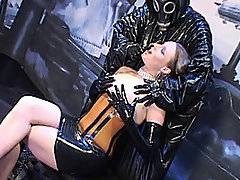 She was approached by a strange being in a latex costume that fondled her meaty pussy. Laura was horny and he could most likely give it to her like she never had before. With his latex, rubbery gloves getting her nice and wet, Laura laid down on the table as he got the heavy guns out. He started drilling into her with a dildo on a power tool that would give her a good fucking. Laura screamed and moaned and really enjoyed the power fucker and even got on her hands and knees and took it from behind. The fucking machine drilled into her pussy with high torque and make her orgasm over and over again.