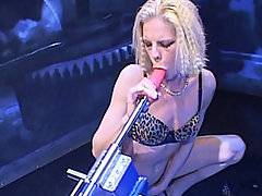 Petite blond rocker babe Leena Styles makes herself cum again and again in this brutal fucking machine clip.  She starts off flaunting her body for the camera, showing off her shaved cunt and cute titties.  She gets the plastic dicky nice and wet and ready for her puss before she slides it into herself doggystyle.  She starts the machine off slow but soon picks up the pace and gets hard nailed from the back while she fingers her asshole.  The anal whore puts it in her butt and switches it up to high, only pausing to lick the mechanical dildo clean again before putting it back in her sodden hole and bringing herself to an incredible climax.