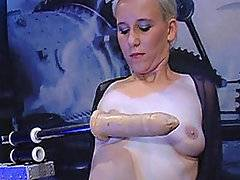 Christine is a sexy short-haired blonde wearing black lingerie that loves the rhythm of FM1000.  While on her knees sucking FM1000 off, she plays with her tits and pussy, getting them all lubed up for her mechanical boyfriend's massive cock.