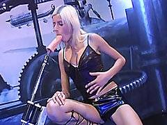 Kathryn is a sensual blonde in black latex who likes it rough.  Fucking Machine 1000 doesn\'t do the gentle cycle, so they naturally hit if off.  Watch this throat gagger take FM1000 to her tonsils before she\'s vaginally and anally dominated.