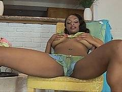 Voluptuous black bbw Carmen Hayes thinks that she is alone as she sits on the couch in her lounge, masturbating furiously.  This girl has got all the curves that a man could want, and she cups her breasts between her upper arms while she furiously frigs her clit.  She hears a noise behind her and whirls around, shocked to see a masked man - pornstar Jenner - crouched on a ledge behind her. He is completely nude, his large prick standing proudly out in front of him. One look at that bristling erection and she knows that she has to have a piece, beckoning him over and then going down on him.  She sits him down on a chair, bouncing on his prick.