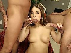 After a slow striptease, Karina is being pawed all over by Andrew and Rick. She is laid back on the bed and fingered while sucking another guy\'s cock. As her pussy is being licked, she realizes that what she really wants is both cocks in her mouth. She gets down on her knees and starts giving them both head in turn. She spends a lot of time with one cock down her throat and another fucking her from behind during a doggystyle bang. She is mouth banged hard core by each in turn and fucked as well. By the time she gets a thick member into her asshole it\'s just a matter of time before she is getting a double cumshot.