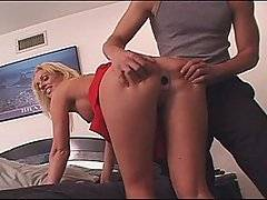 Sports jocks Mark Ashley and Dez are playing some football out on the field when they are approached by busty blond cheerleader Cailey Taylor.  The dirty whore lures them into the changing rooms, telling them that she has got something that she wants to show them.  Both studs are understandably surprised when she whips up her skirt, revealing the fact that she has got a butt plug shoved right up her ass!  No more words are required as the studs gather around her, pulling off her clothes and shoving their cocks in her mouth.  Both guys give her a good pussy fucking before the pull the butt plug out, banging her ass just as hard.