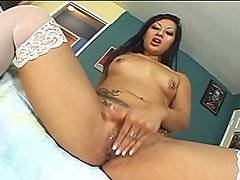 Insatiable Asian whore Gianna Lynn is hungry for cock, and as soon as her man Nick East enters the set she veritably jumps him.  Pushing the surprised stud down onto the couch, she gives his dick a quick lick and then straddles him, lowering her tight, slippery slit down onto his man meat.  She bucks and grinds on him passionately, desperate both to pleasure her man and to make herself cum on his cock.  Nick takes over, holding her firmly just how he likes it and really pounding it into her, making her gasp and quiver all over.  Finally he drains his balls into her mouth, and she leans forwards so she doesn\'t miss a drop of his tasty spunk.