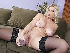 Slutty and voluptuous blonde Kala Prettyman introduces herself and answers some questions for the camera while dressed in sheer pink lingerie.  She removes her top to free her large natural tits and she slides her panties off and sits back on the couch, spreading her legs wide so she can play with her pussy with a dildo and vibrator.  She\'s joined by a horny black dude, and he eats out her pussy before they 69.  She sucks him off and he tit fucks her before she lays back to take it missionary.  She rides him reverse cowgirl and he spoons her, and he nails her doggy-style before giving her a messy cream pie.
