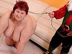This is definitely one of the stranger porn videos that you will watch.  At the outset of the clip, an enormous fatty crawls around on her hands and knees on the floor, with a dwarf dressed up as Santa riding on her back.  There\'s a big smile on the fatty\'s face - she obviously loves to be treated like nothing more than a hefty beast of burden!  She blows the midget, who has a surprisingly large cock, and then lies back with her chunky legs spread on the sofa to get plowed by the diminutive man.  At the end of the vid, the pint sized dude stands up on a ladder so that the fatty can suck him off.  He\'s got a huge load for a little guy!