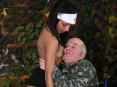 Just because he\'s in a wheelchair, and missing a leg, that doesn\'t mean that this older gentleman doesn\'t need relief!  It\'s just lucky that he\'s got such a loving and considerate nurse.  It doesn\'t hurt that she is an absolute babe!  Of course, at the touch of a nubile young babe like this, even this older gentleman\'s prick springs to attention!  He ends up getting a suck job from the cute young nurse, who then straddles him and eases his hard prick into her tight young pussy.  She rides him until the old man is ready to cum!