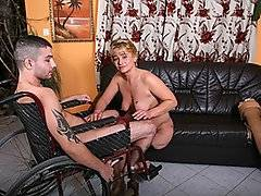 Barnafi Ferencne is one hot chick.  Although an amputee, she still has the use of her sexuality.  She proves it with an unknown male in a wheelchair.  Off with her Prosthetic leg and she starts with a blowjob.  Soon they are on the couch spooning and moaning.  In missionary style she gets her pussy pounded by his stiffened rod.  The stud sits down and she climbs his ram and slowly rides him.  Doggy-style now she gets her juicy wet cunt pounded from behind.  A quick blowjob to kip his stiff and then back to doggy-style.  Finishing up missionary again, he slams her womanhood hard and deep.  Reaching the end he rubs one off all over her juicy wet pussy.