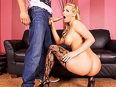 With those hot pouting lips and those massive fake titties, stacked blond Phoenix Marie is just begging for cock!  She looks especially sensational in some delightful and extremely elegant stockings and high heels.  Stud Danny Mountain, his enormous prick extended out in front of him like a battering ram, can\'t believe how good it feels to have this horny cocksucker\'s mouth working his shaft.  Once Phoenix has got the penis nice and stiff, she gets it deep on the sofa, inciting her man to give it to her even harder and rougher.  She jerks the spunk load out into her mouth at the end of the video, allowing the sperm to dribble off her tongue.