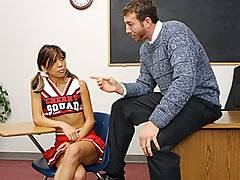 When this hot captain of the cheerleading squad gets caught smoking on school grounds, the teacher threatens to tell her parents unless she dines on some dick. She takes him up on his offer and swallows a footlong cock before taking it deep inside her tight and moist asian pussy.  Watch as her ass gets slapped silly while riding the teacher\'s cock, before she takes a warm load on her tongue.