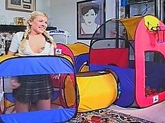 After playing in the ball tunnel this sweet blonde beauty gets her throat plunged with a giant black cock -- then takes it deep in her cunt, like any good girl should.