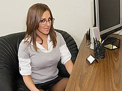 The boss is having a loud argument on the phone with his wife when his sexy secretary walks in, stunning brunette Kiera King.  The boss, porn stud John Strong, slams down the phone in disgust.  Lucky for him his beautiful secretary is standing there right in front of him, looking stunning in her short skirt and glasses.  The sexy strumpet knows exactly what to do, walking around to the other side of the desk, kneeling in front of her boss and unzipping his pants.  His cock springs to attention as she begins to massage it, coyly taking the shaft in her mouth and beginning to suck.  She delivers an excellent blowjob like he never gets at home!