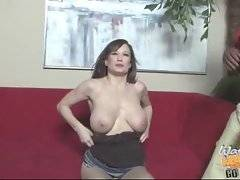 Large tited brunette milf skilfully sucks two thick black cocks.