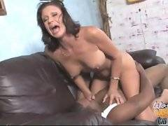 Mommy loves sliding up and down on a fat black stick