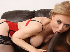 I'm xxx porn star Nina Hartley and I'm no stranger to making dirty, filthy interracial porn movies. I've fucked a ton of black guys in many interracial sex videos but today I got a young one with a cock I wasn't sure would fit in me. His name is Ice Cold and his black dick is so big it could be his third leg or even a belt. I wanted to make sure I would get ample time to slide it in my mouth hoping it would go past my tonsils but my gag reflex kicked in. Damn! I was so happy that he was hard the moment he dropped his pants which is a nice change of pace since my white male co-stars are as limp as a noodle and as wide as one, too. My white pussy got wetter and wetter as I sucked him so riding his huge cock was a given. He tossed me all around that sofa and shot a 2 foot cumshot which was as thick as a tidal wave. I knew Cougars like me love lots of cum but this was insane!
