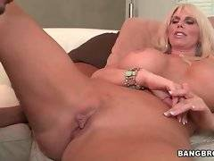 Big tited naked mamma knows how to make her pussy wet.