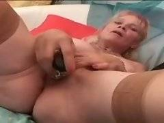 Naughty woman in brown stockings and fat ass