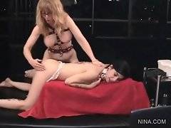 Skilful Nina Hartley is licking her bitches butt