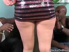 Good looking english babe chatters with her black friends.