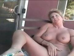 Breasted old slut sits naked on chair and plays her pussy.