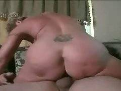 Busty granny passionately jumps on her younger lover.