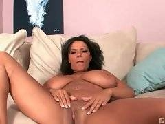 Naughty whore is masturbating her pussy on the sofa