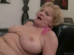 Sexual bitch likes to kiss her big tits in the room