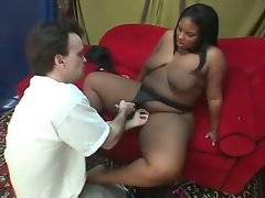 Nasty ebony plumper works her feet to tender lover`s cock.