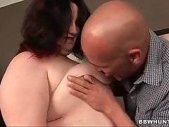 Naughty whore is showing her big tits in the room