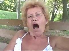 Grandma in white lingerie pleasures her old love hole.