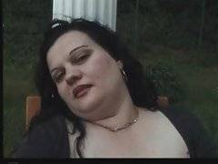 Fat baroness is playing with her pussy outdoors