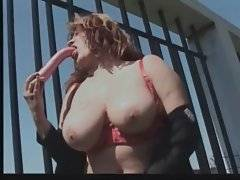 Bewitching granny with astonishing tits is sucking her dildo