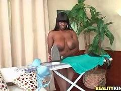 Topless huge tited ebonie irons her clothes.