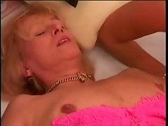 Brave and slutty bitch is doing blowjob on the bed