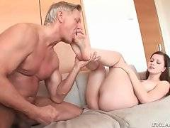 Skilful daddy is drilling her pussy on the bed