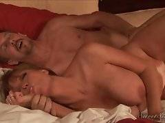 Horny mature couple has fun in their big family bed.