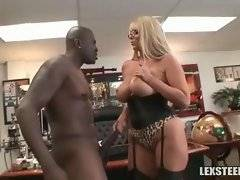 Black man tenders and tastes chick`s large tits.
