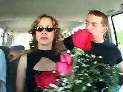 Guy presents pretty lady flowers and wants to get know her closer.