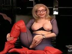 Ravishing Nina Hartley is playing with her kitty